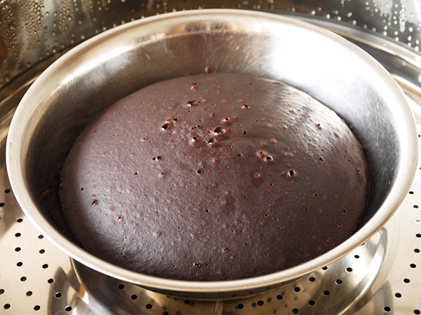 carefully lift the lid and remove the cake gently from the steamer