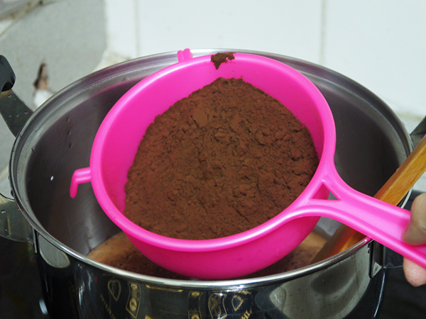 pour milk in a pot, sieve the cocoa powder into the milk, stir until combined